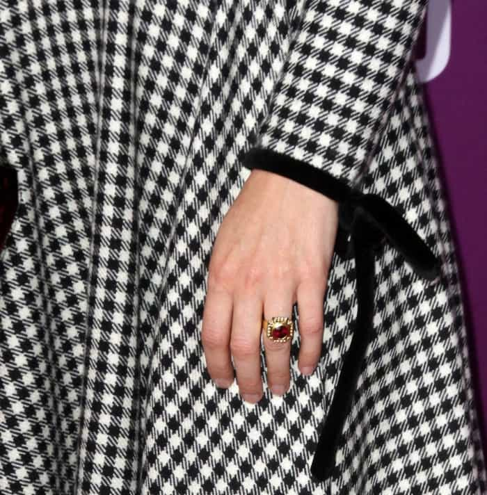 "Sarah Paulson wearing a black and white vintage Valentino gingham dress, Nicholas Kirkwood ""Leda"" pumps in black suede, and Jacob & Co. jewelry"