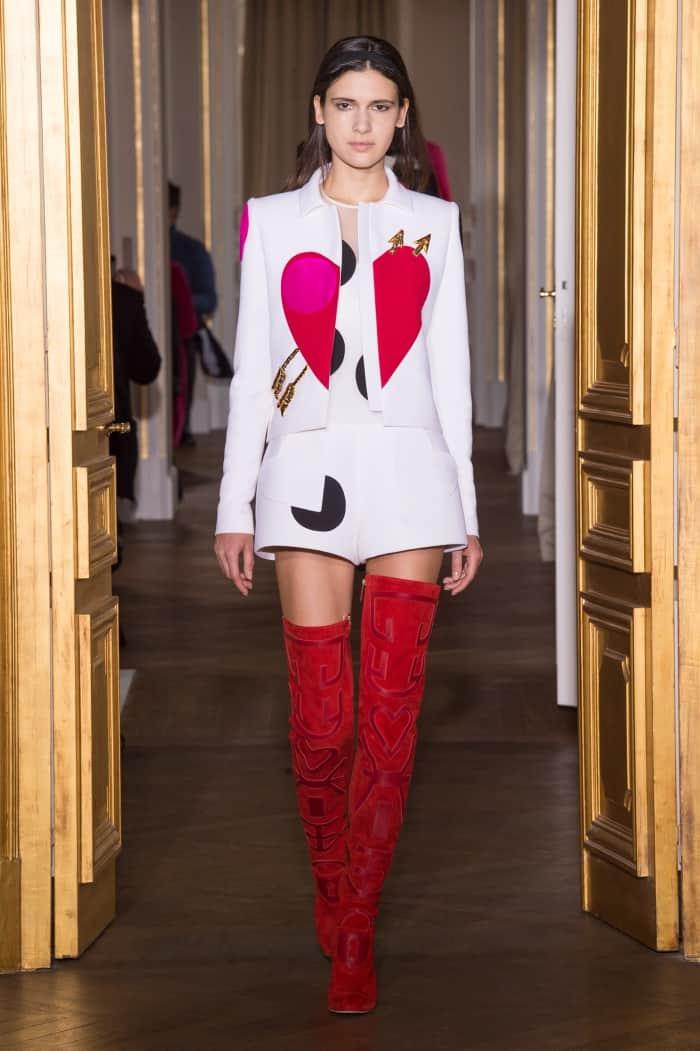 "Model wearing the Schiaparelli Mixed-Material ""Heart"" Thigh-High Boots"
