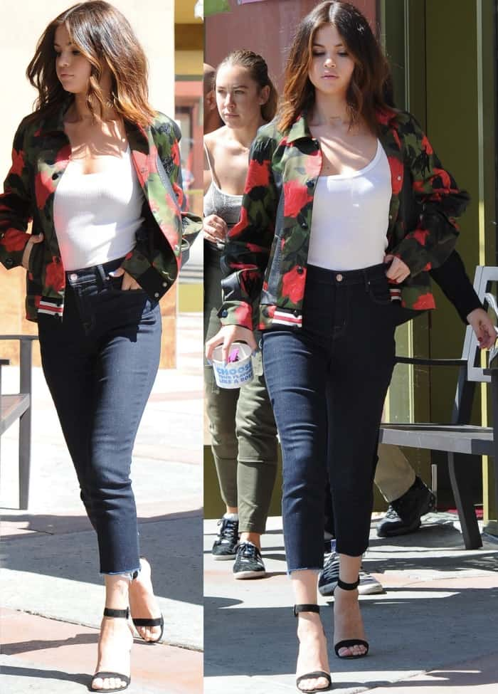 """Selena Gomez wearing a Coach varsity jacket, Isabel Marant Etoile tank top, J Brand jeans, and Gianvito Rossi """"Portofino"""" sandals while out and about in Los Angeles"""