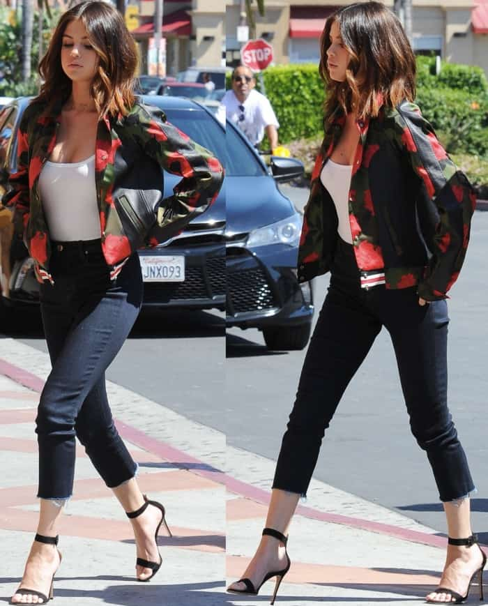 "Selena Gomez wearing a Coach varsity jacket, Isabel Marant Etoile tank top, J Brand jeans, and Gianvito Rossi ""Portofino"" sandals while out and about in Los Angeles"