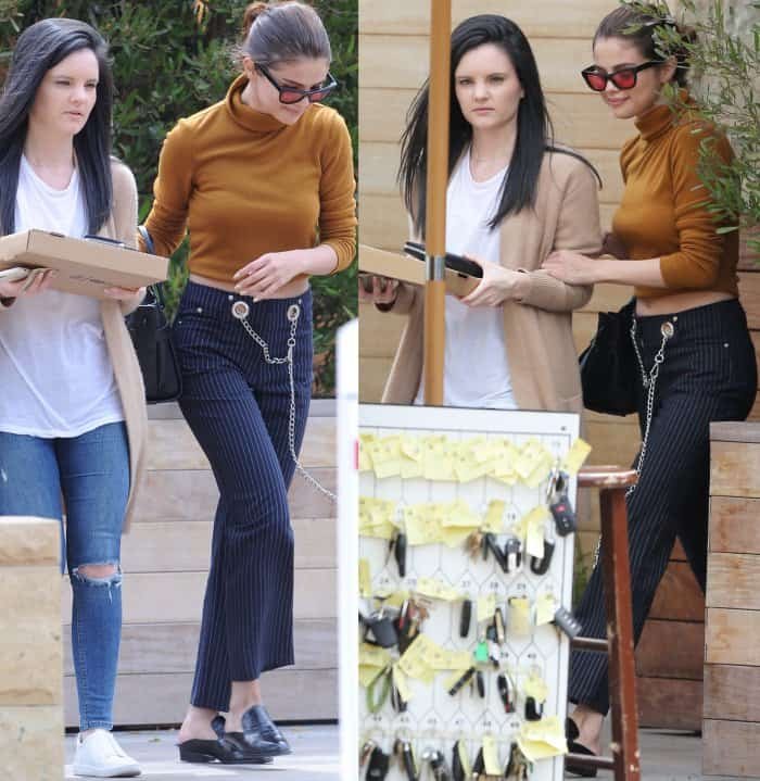 """Selena Gomez wearing a Wayf fold-over turtleneck, Miaou """"Tommy"""" pinstripe jeans, and Robert Clergerie """"Alice"""" mules while out and about in Malibu"""
