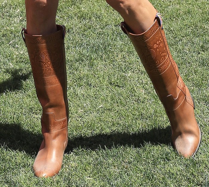 Alessandra Ambrosio finished her country chic ensemble with a pair of brown leather boots