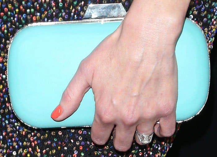 Alexis Bledel inserts a pop of color into her outfit with a tiffany blue Lili Radu clutch