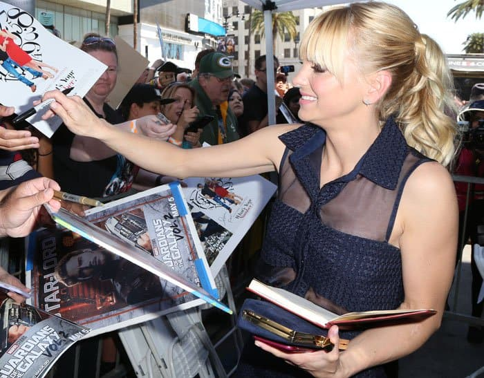 The actress signs autographs for her fans
