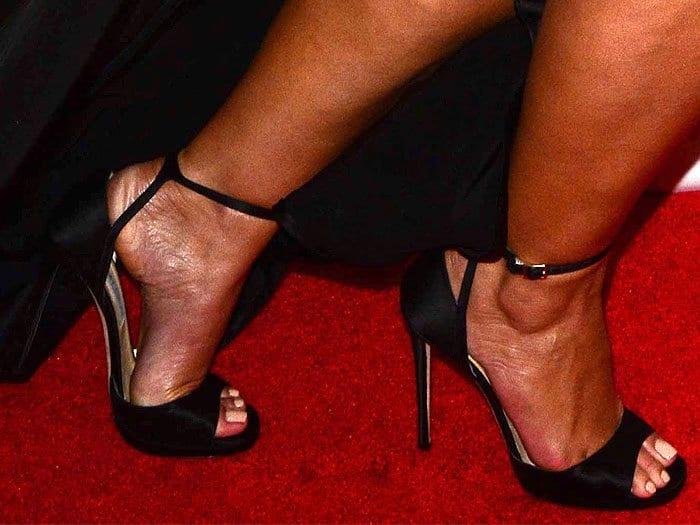 "Ashley Graham's feet in Jimmy Choo ""Pearl 120"" black satin sandals"