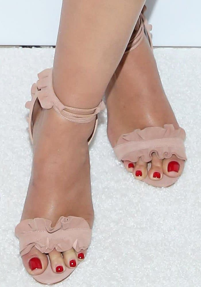 """Ashley adds some romantic flair to her look with a pair of Schutz """"Irem"""" sandals"""