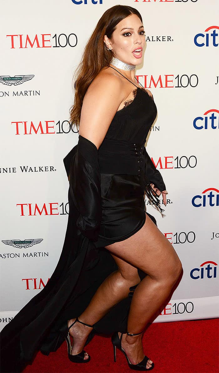 Ashley Graham stumbling on the red carpet at the 2017 Time 100 Gala as her heel gets caught on the hem of her skirt