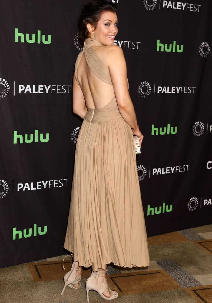 Sexy back: the 47-year-old shows off her dress' back cutout
