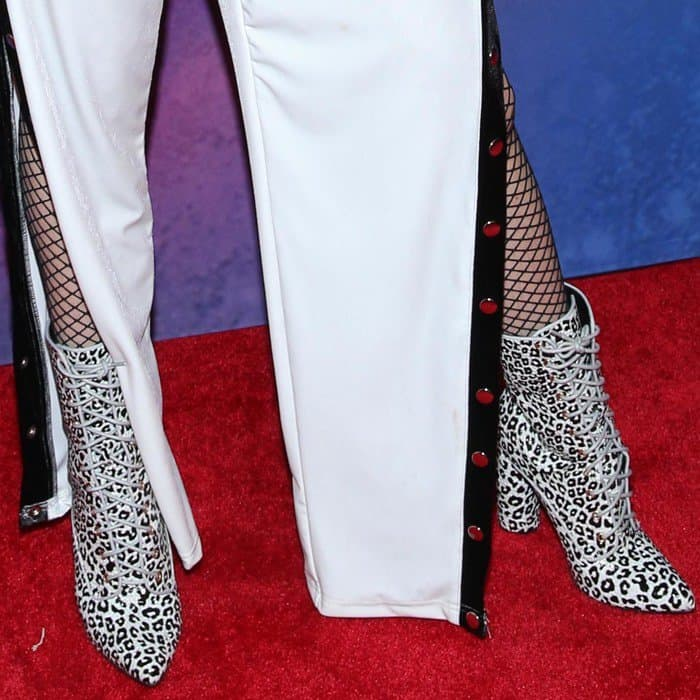 Bella Thorne wearing leopard Dolls Kill 'Katty So Posh' lace-up boots