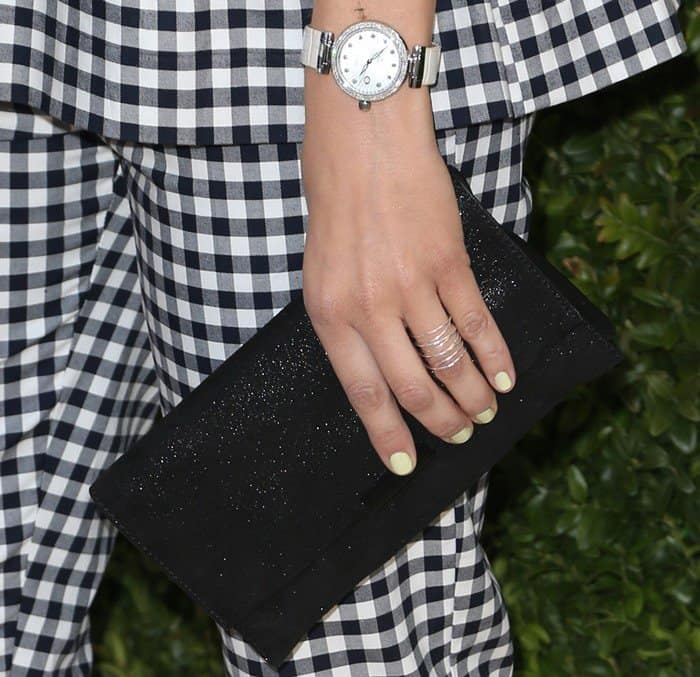 Camilla shows off her jewelry and clutch