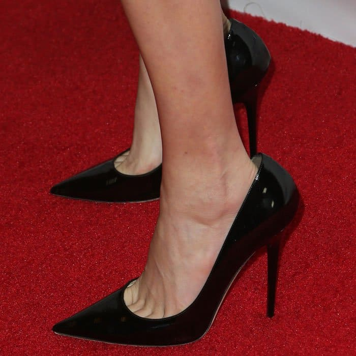 "Closeup of the Jimmy Choo ""Anouk"" pumps in black patent on Cara Delevingne."