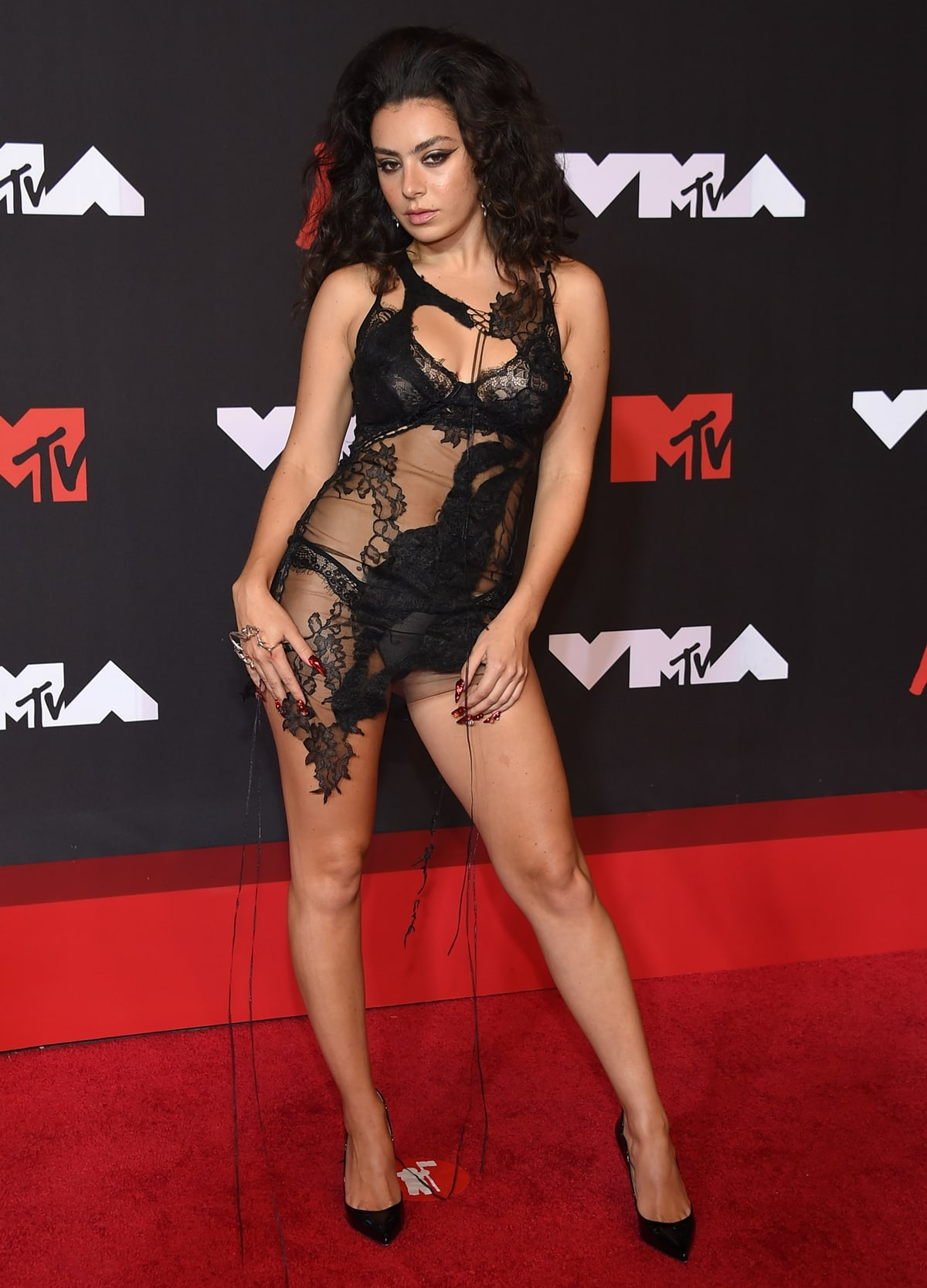 Charli XCX in a lacy black mini dress at the 2021 MTV Video Music Awards