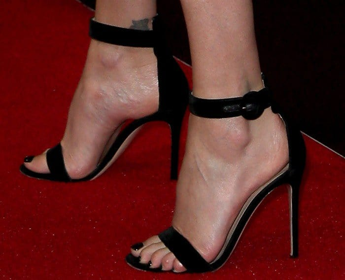 Charlize Theron in black ankle-strap sandals
