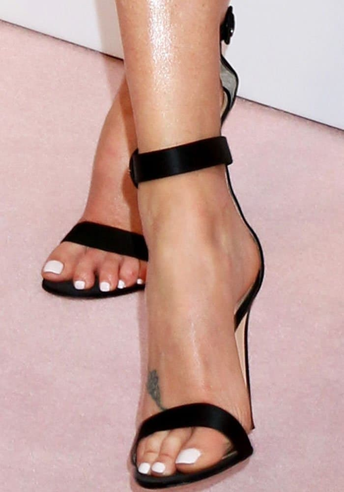 "The actress keeps things classic in a pair of Gianvito Rossi ""Portofino"" sandals"