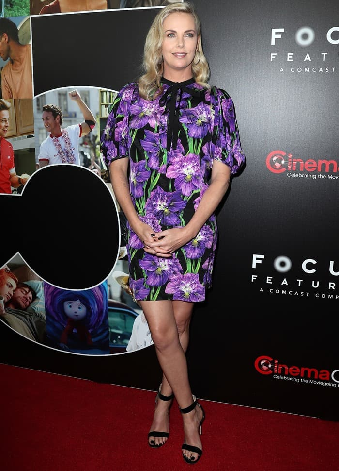 Charlize Theron in a floral Gucci mini dress at CinemaCon 2017 in Las Vegas on March 29, 2017