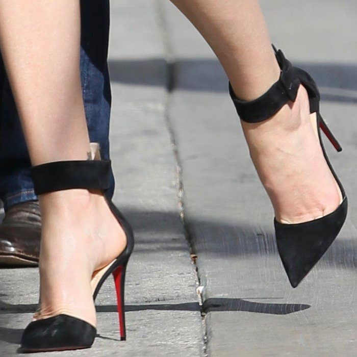 Charlize wearing Christian Louboutin's pointy-toe 'Harler' pumps