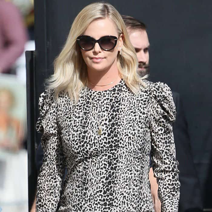Charlize Theron wearing a puffed-sleeve leopard dress for an appearance on Jimmy Kimmel Live in Los Angeles on April 14, 2017