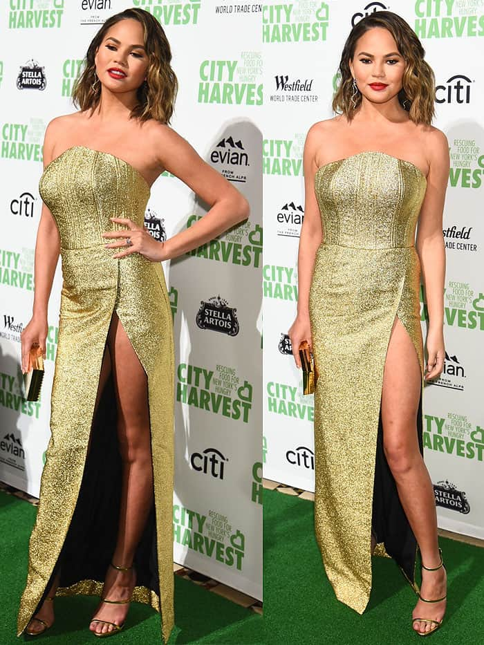 Chrissy Teigen looking confident despite her wardrobe malfunction in an Angelys Balek Fall 2017 gold strapless gown