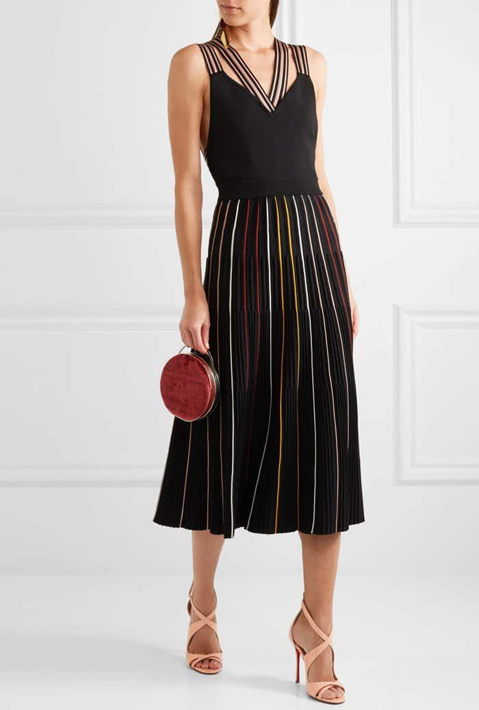 Model wearing Christian Louboutin's 'Malefissima' sandals with Roksanda's 'Shiori' striped ribbed stretch-knit dress and Eddie Borgo's 'Chet Minaudiere' bag