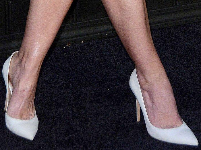 """Closeup of the Christina Ricci's white Gianvito Rossi """"Gianvito"""" pointy-toe pumps."""
