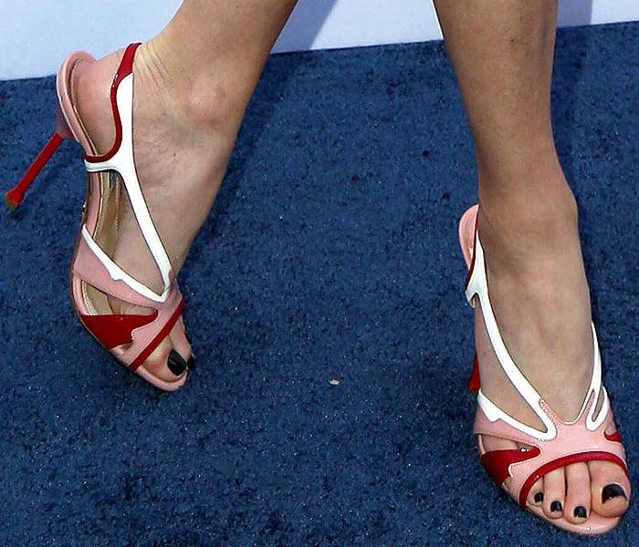 Closeup of Elizabeth Banks' Prada patent colorblock slingback sandals.