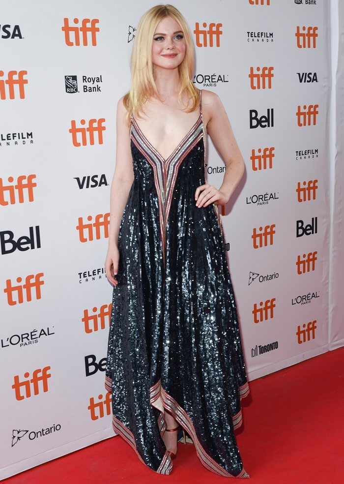 Elle Fanning in a sequined Valentino dress andred satin Tania strappy mules from Giuseppe Zanotti