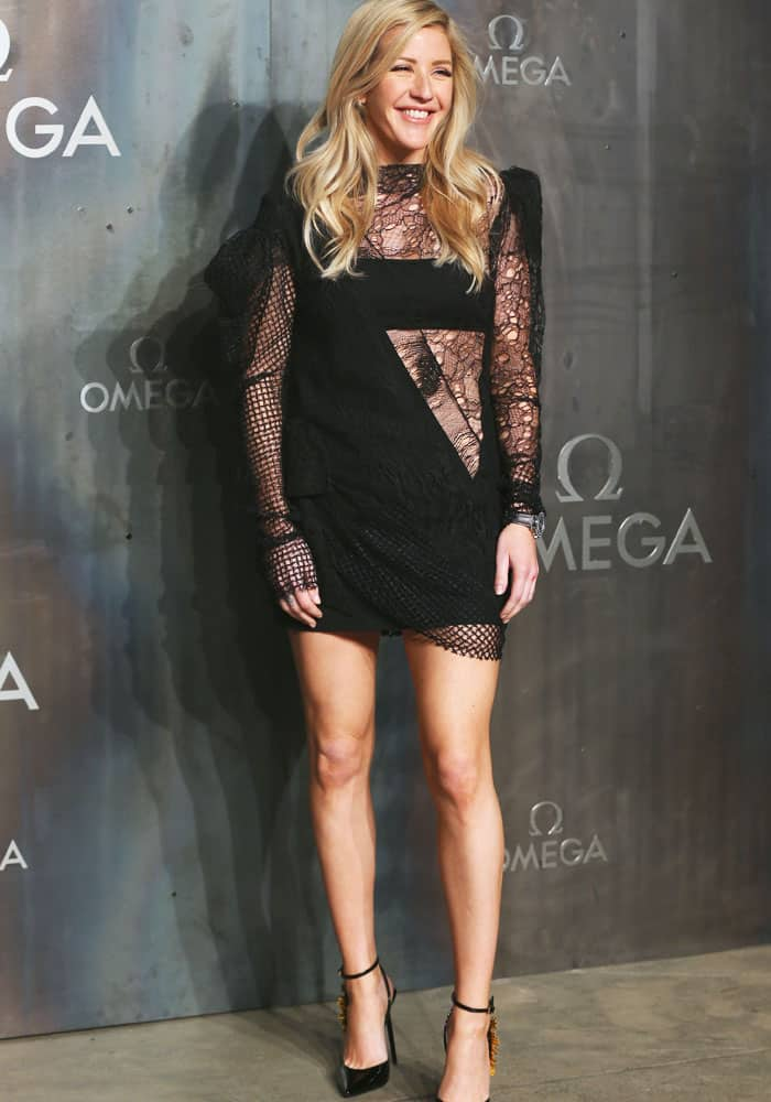 Ellie is all-smiles as she stepped out in a Saint Laurent lace and panel dress