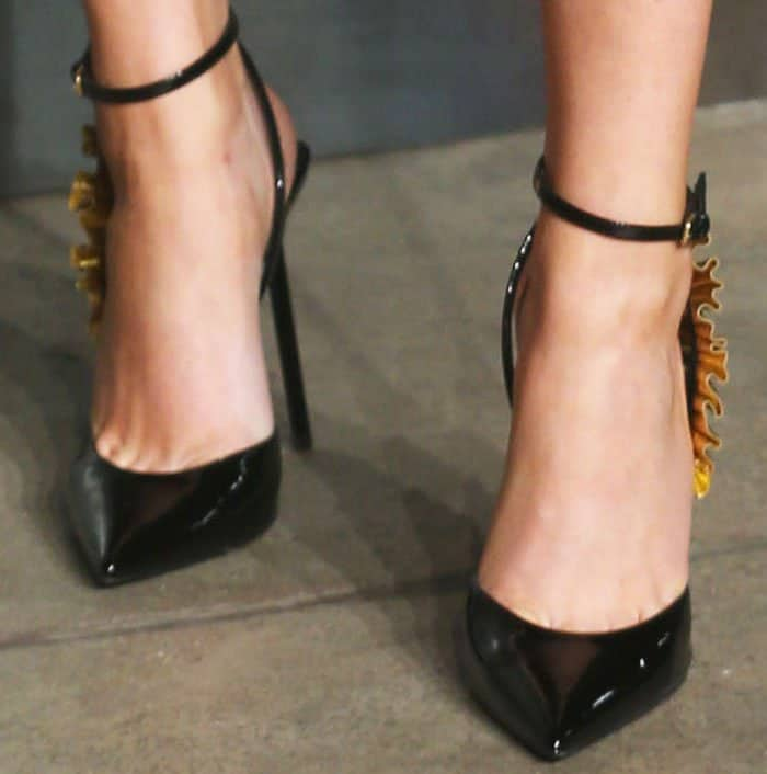 """Ellie mixes the romantic and classic in a frilled Saint Laurent """"Edie"""" pumps"""