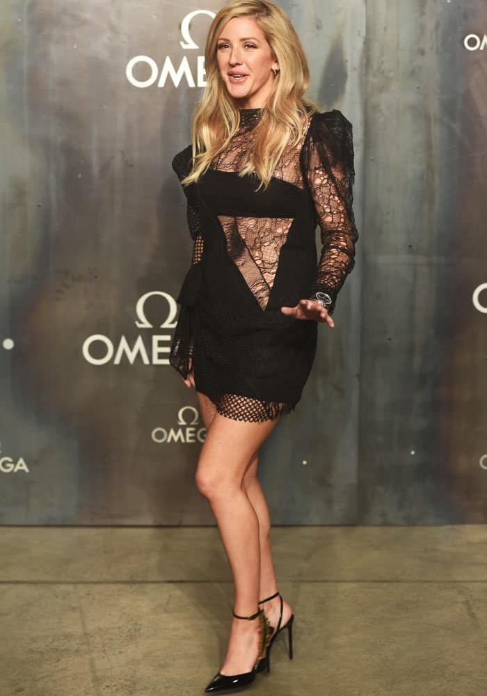 Ellie is gets friendly with the paparazzi in her head-to-toe Saint Laurent outfit
