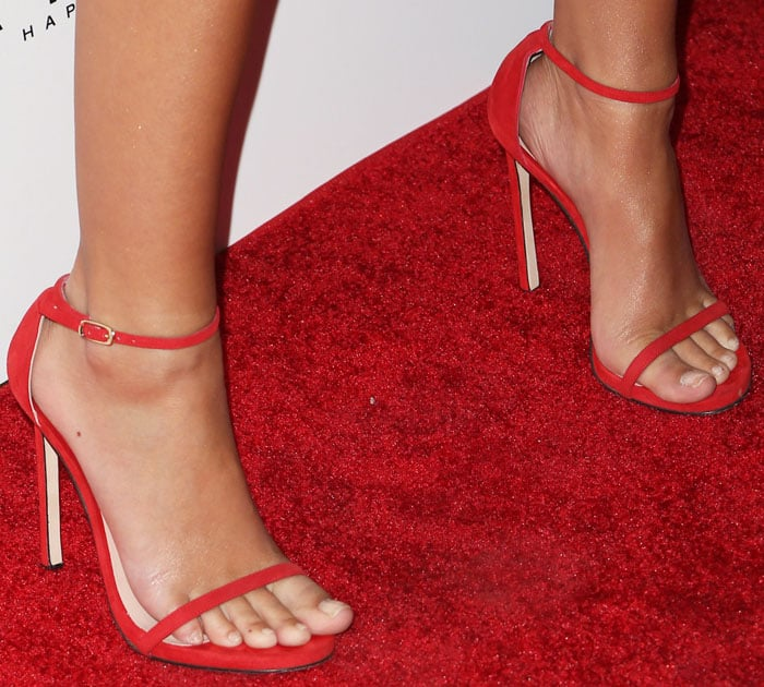 Emily went matchy-matchy with a red pair of Stuart Weitzman 'Nudist' sandals