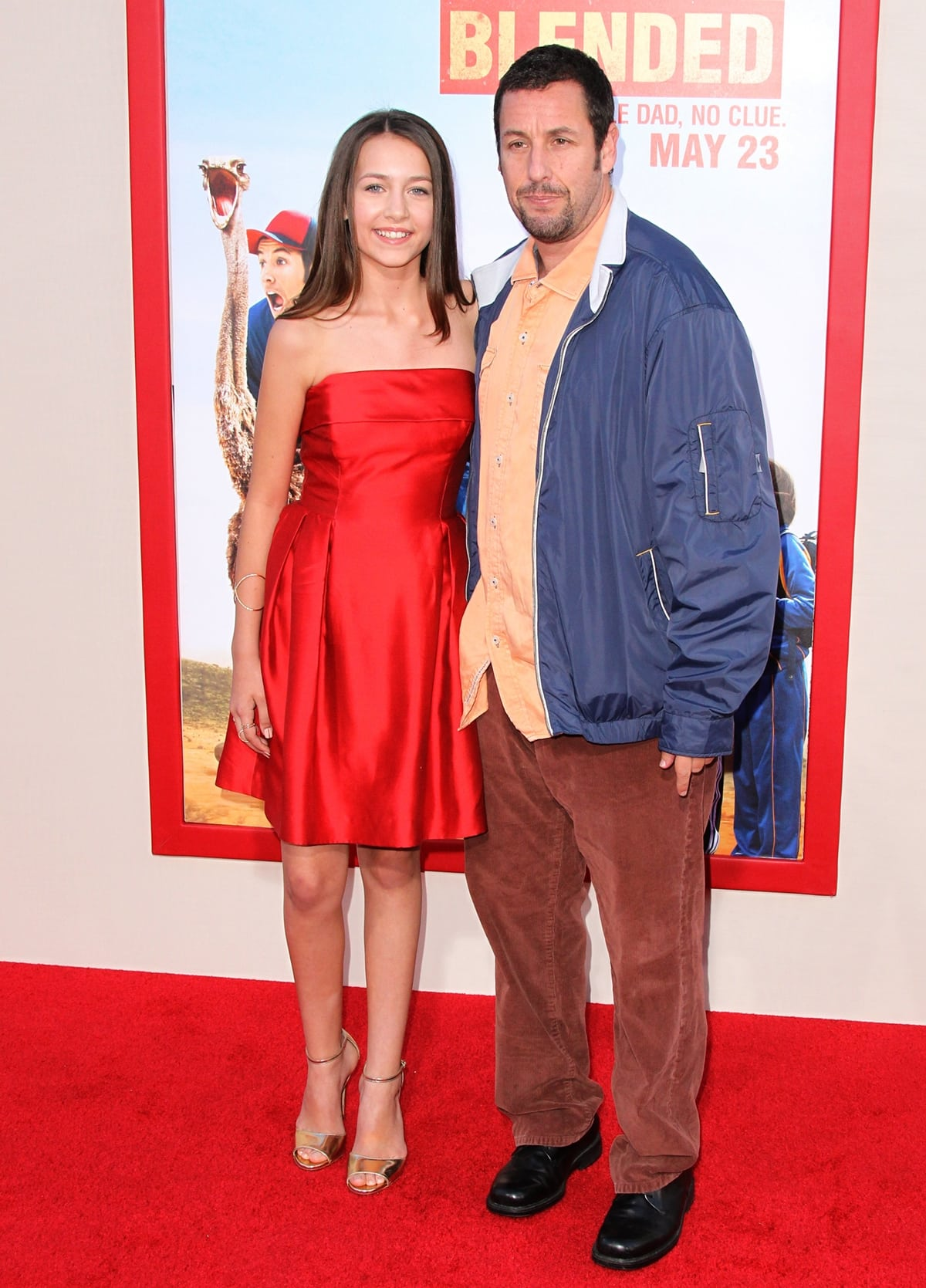 Emma Fuhrmann in a Shoshanna dress, Jerome C. Rousseau heels, and XIV Karat and EF Collection jewels, with her co-star Adam Sandler