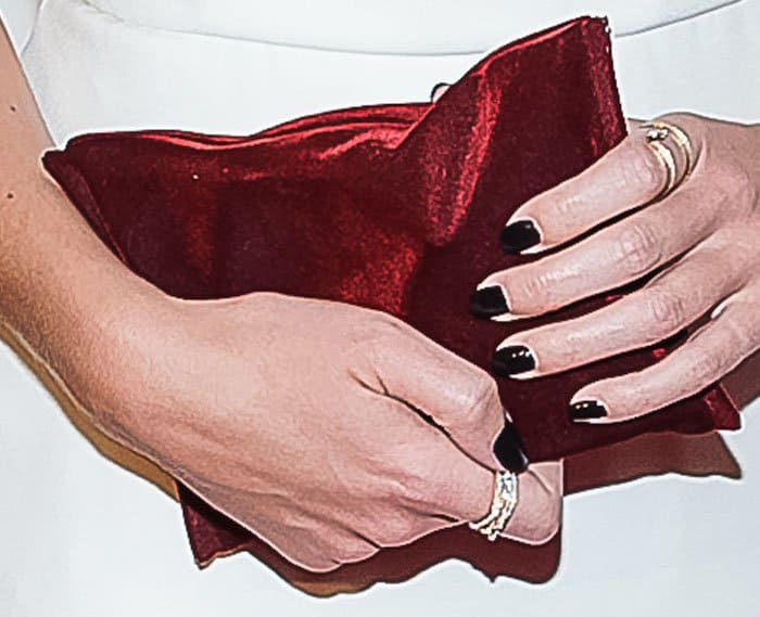The actress shows off her Monique Pean rings and Anya Hindmarch clutch