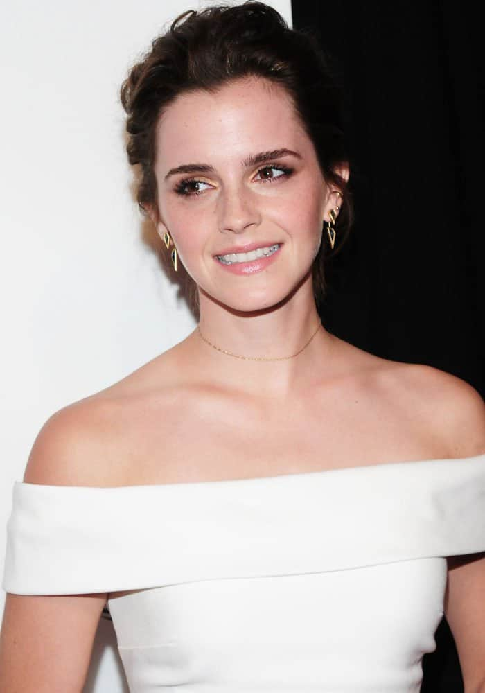 Emma shows off her gorgeous shoulders in an Burberry gown