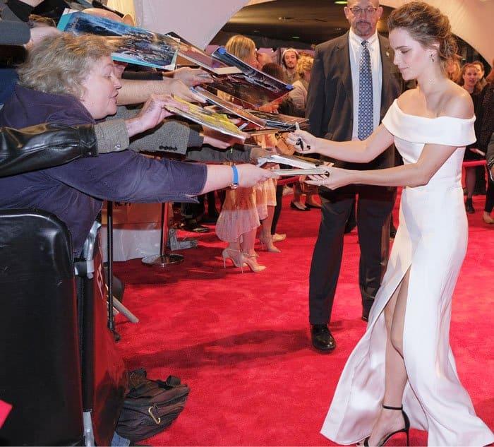 Emma signs autographs for her ecstatic fans
