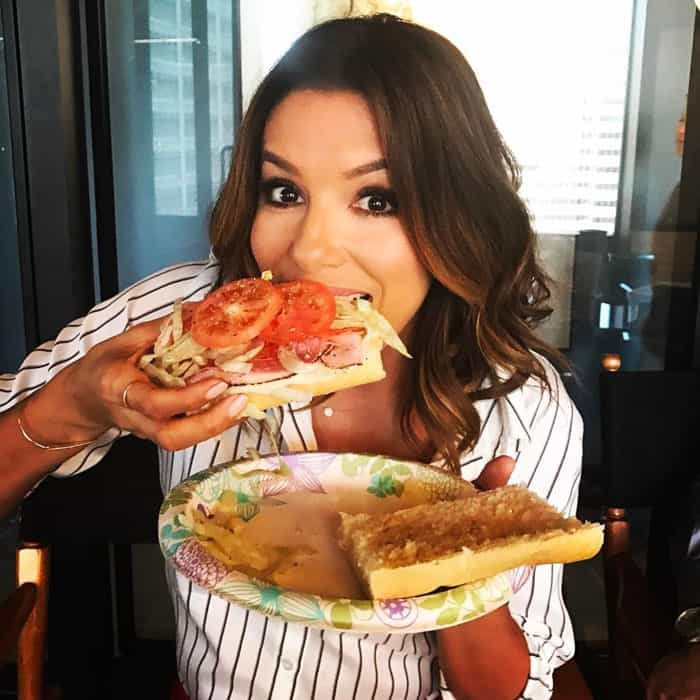 Eva digs into a scrumptious looking sandwich behind the scenes