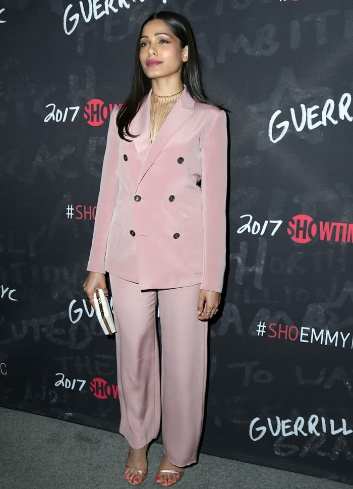 Freida Pinto in a Bally pink pantsuit from the Spring 2016 collection at the Emmy: For Your Consideration screening of 'Guerrilla' held at The WGA Theater in Beverly Hills on April 13, 2017