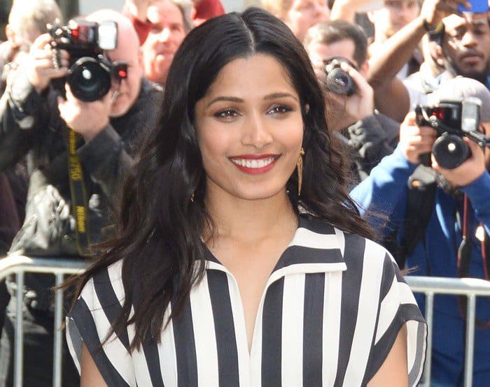 Freida Pinto wearing a black and white stripe silk crepe dress in New York City on April 3, 2017