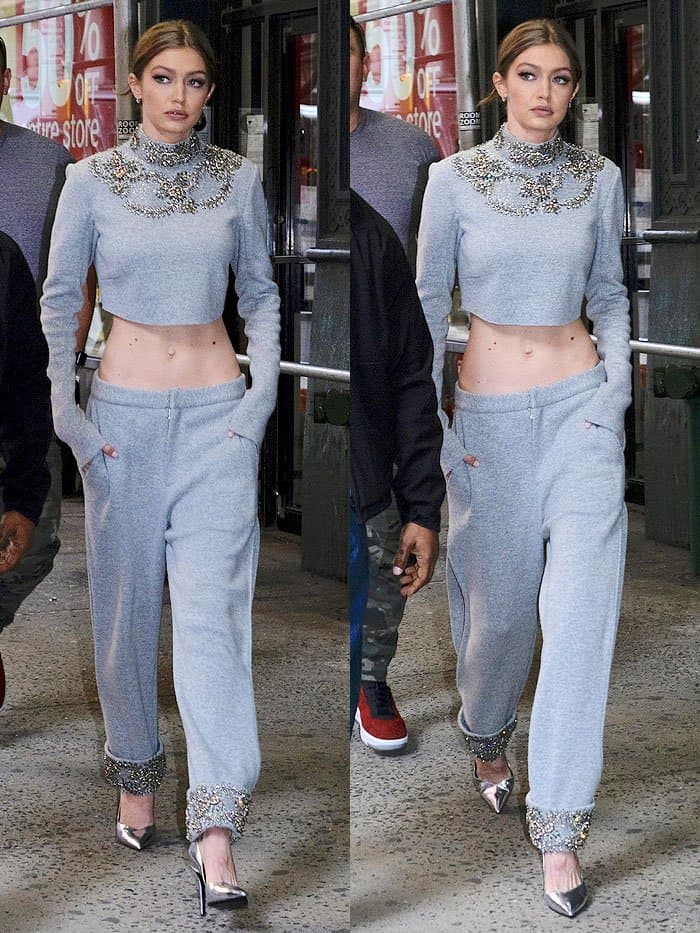 Gigi Hadid in gray embellished crop-top sweatpants leaving a building in SoHo in New York City on April 12, 2017.