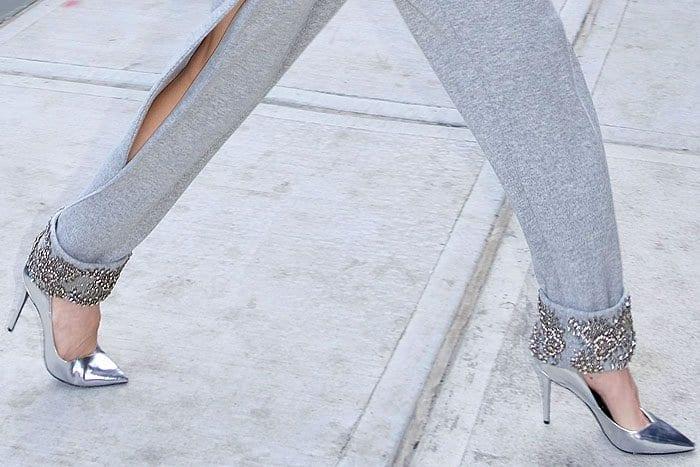 """Closeups of the Stella Luna """"Indispensable Classic"""" classic pumps in silver specchio on Gigi Hadid."""