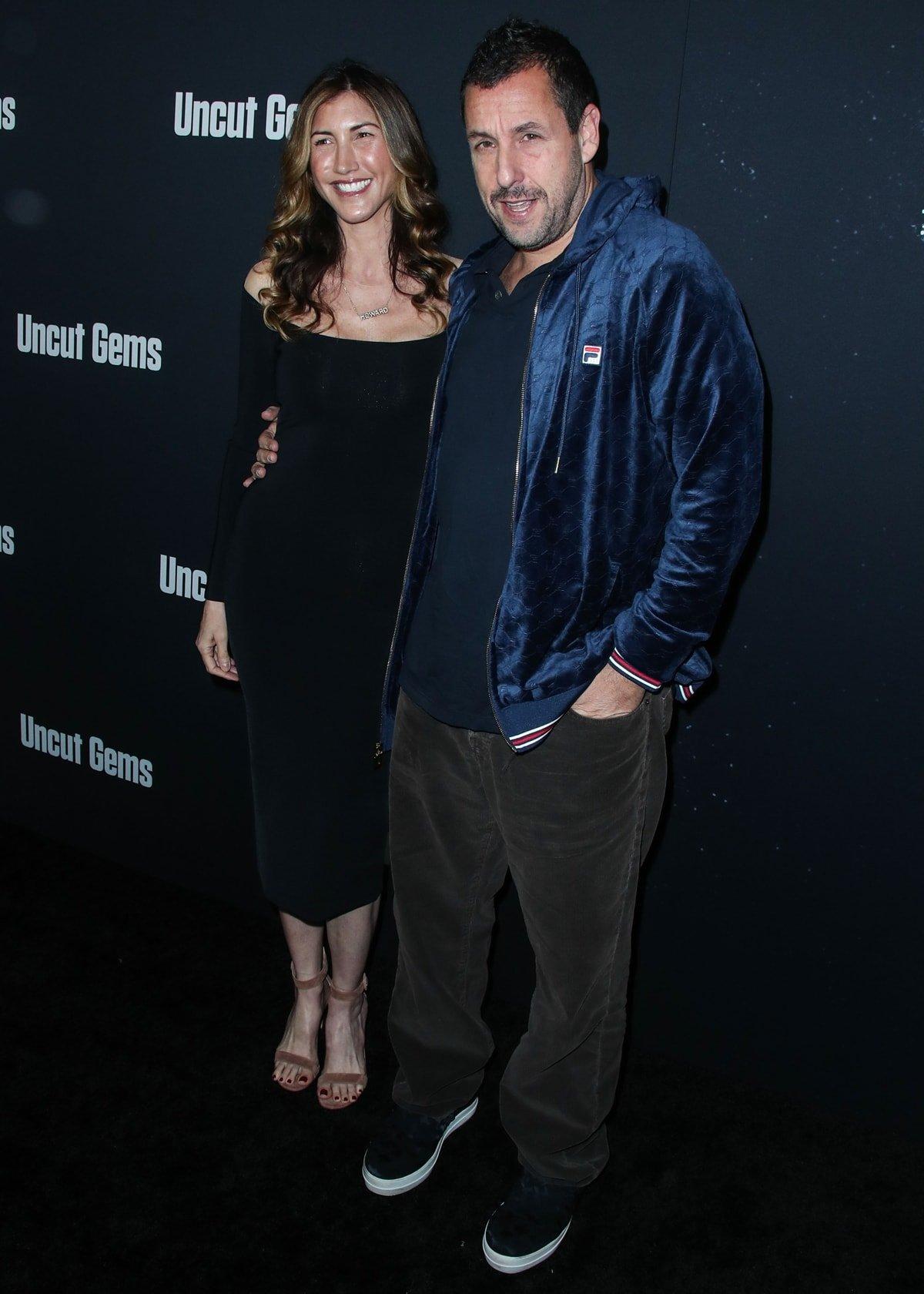 Jackie Sandler and her husband Adam Sandler arrive at the Los Angeles Premiere Of A24's 'Uncut Gems'