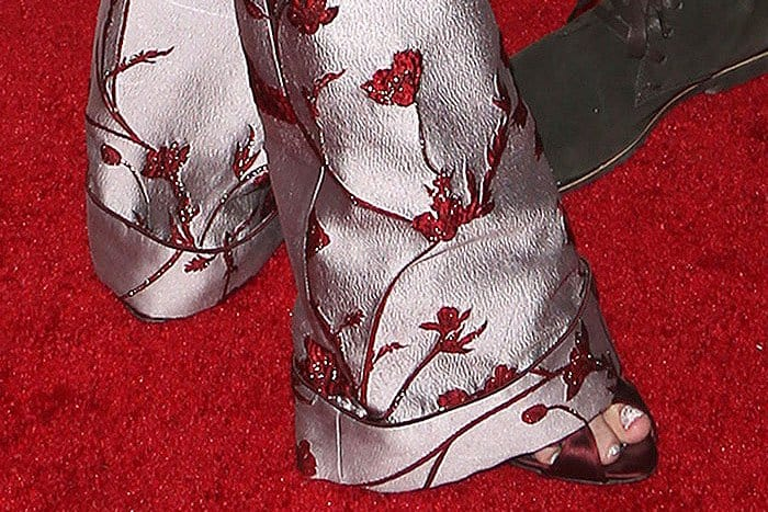 Giambattista Valli Fall 2013 patent-and-satin belted-strap sandals peeping out from the hem of Jaime King's Johanna Ortiz Jacinta jacquard pants
