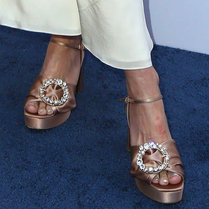 Jaime King wearing Miu Miu embellished-buckle satin platform sandals.