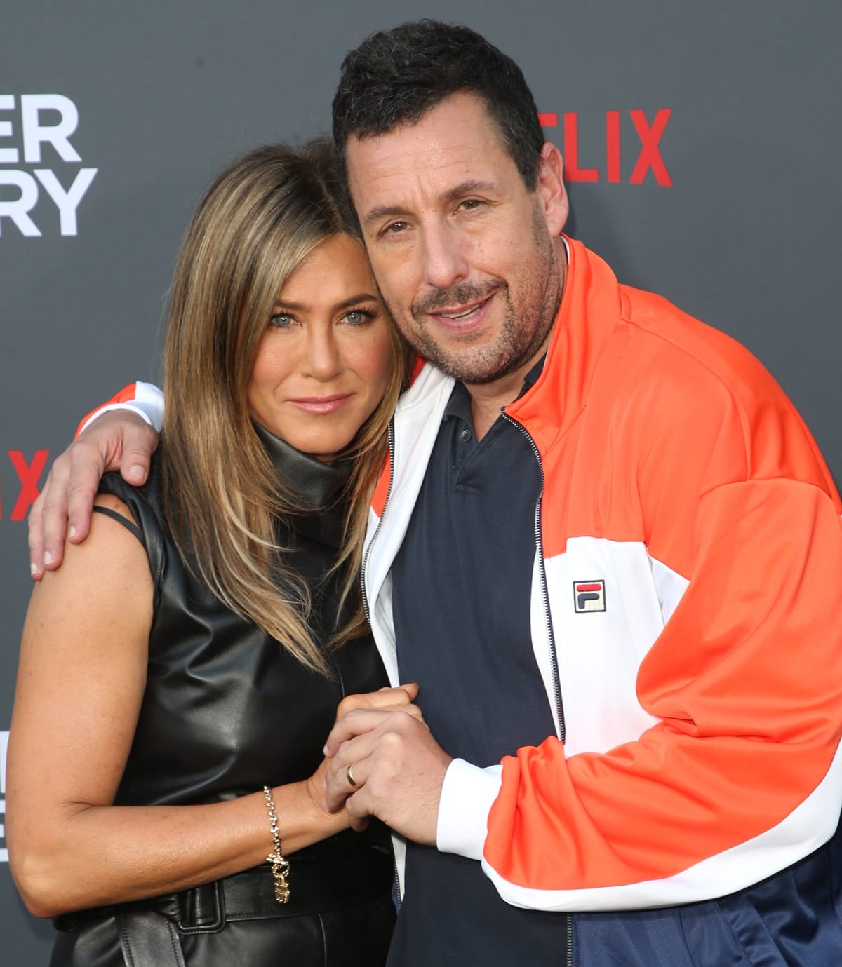Adam Sandler's wife taught him how to kiss his Murder Mystery co-star Jennifer Aniston