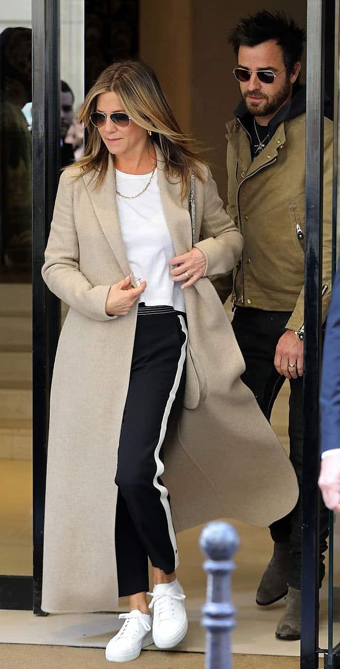 Jennifer Aniston rocks a nude-hued duster coat