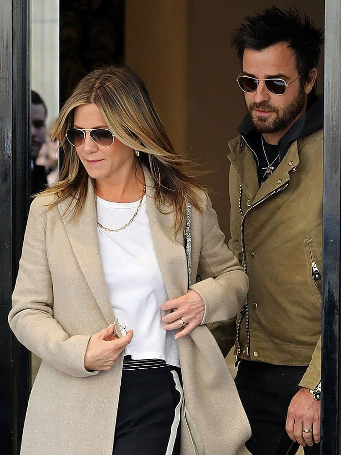 Jennifer Aniston styled her pants with a longer-cut crop top