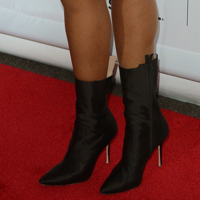 Jennifer wearing Vetements x Manolo Blanhik ankle boots