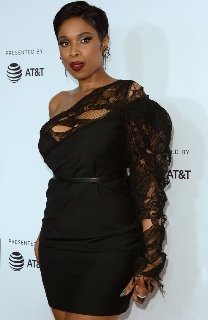 Jennifer Hudson wore a black Saint Laurent mini dress to support music producer Clive Davis at the premiere of 'Clive Davis: The Soundtrack of Our Lives' during opening night of the Tribeca Film Festival at Radio City Music Hall in New York City on April 19, 2017