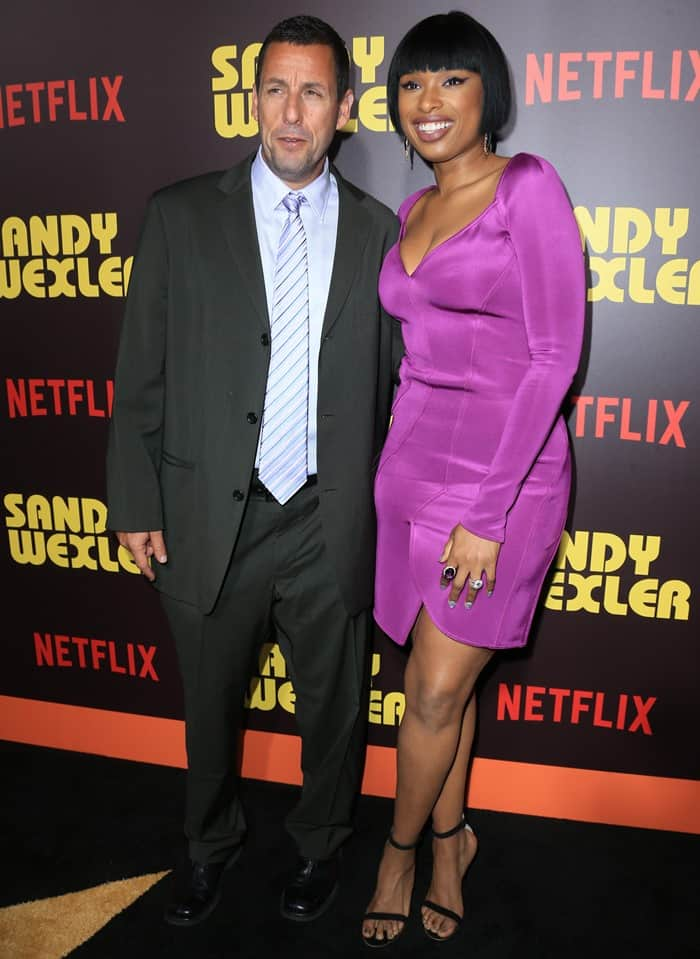 Jennifer posing with her co-star Adam Sandler