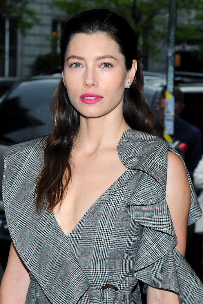 Jessica Biel toned down the formality of the plaid print with the deep neckline and tortoise shell rings at the wrap waist