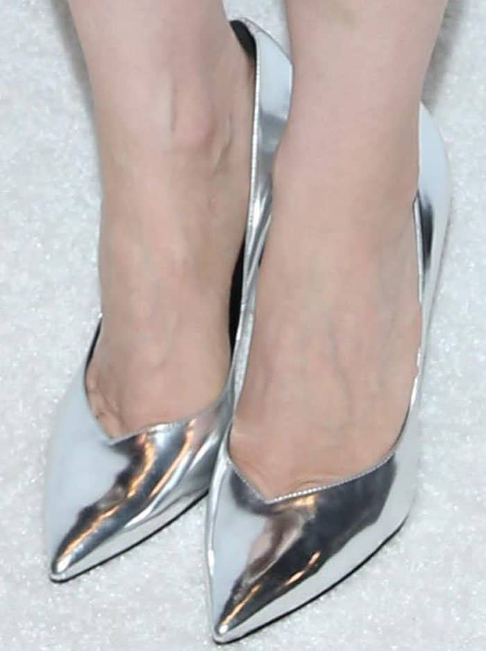 "The actress puts a little modern twist to her classic look with a pair of metallic Saint Laurent ""Paris"" pumps"